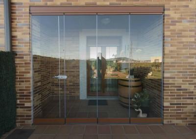 12 – Cerramiento de terraza con cortinas de cristal